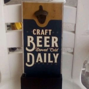 wall hanging with a beer tab remover and small bo